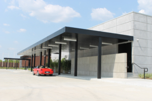 Showing an aluminum canopy protecting the entryway to a building.