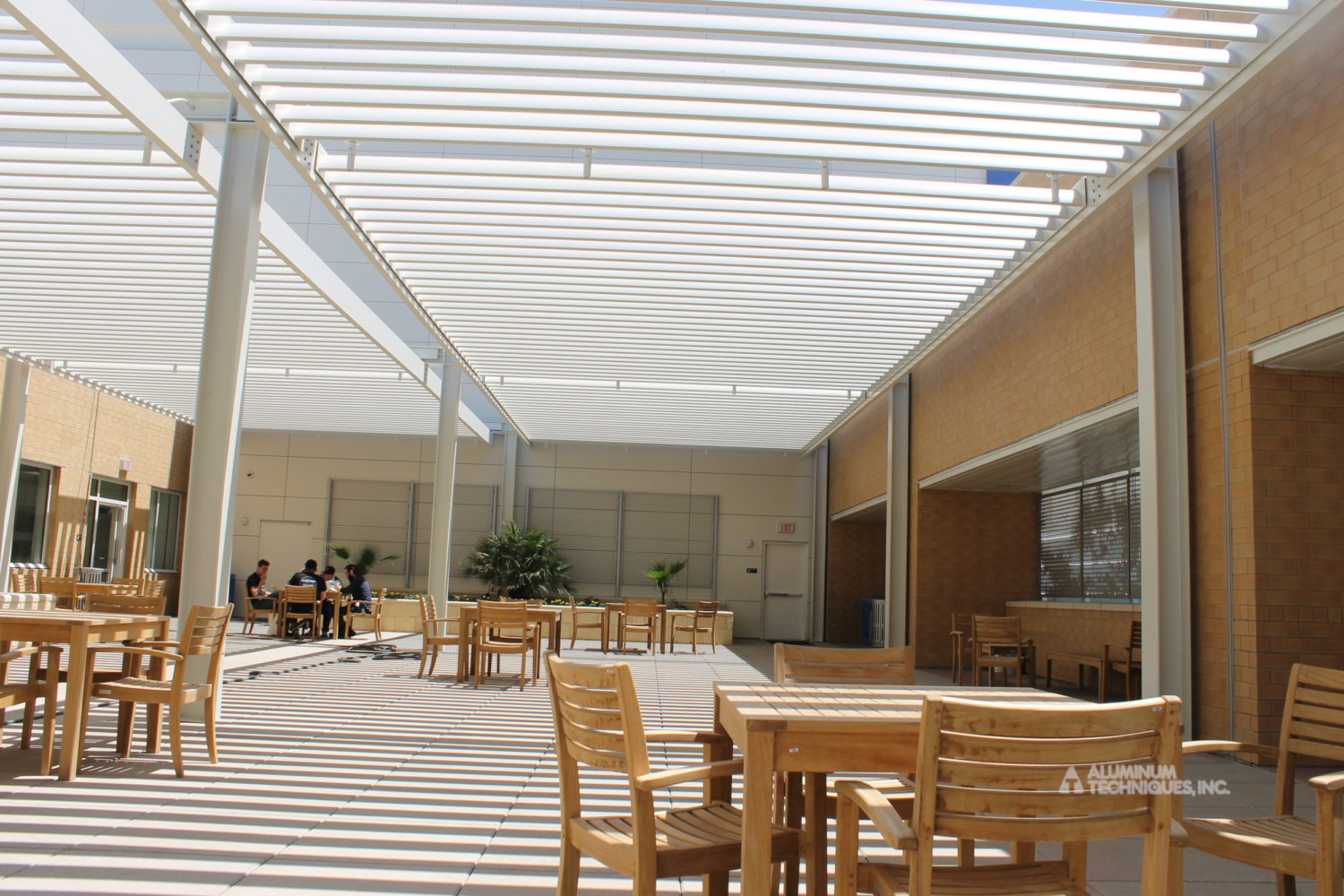Showing shade structures that protect an outdoor patio.
