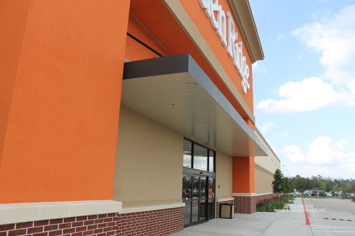 Showing a canopy protecting the entryway to a big box retail store.