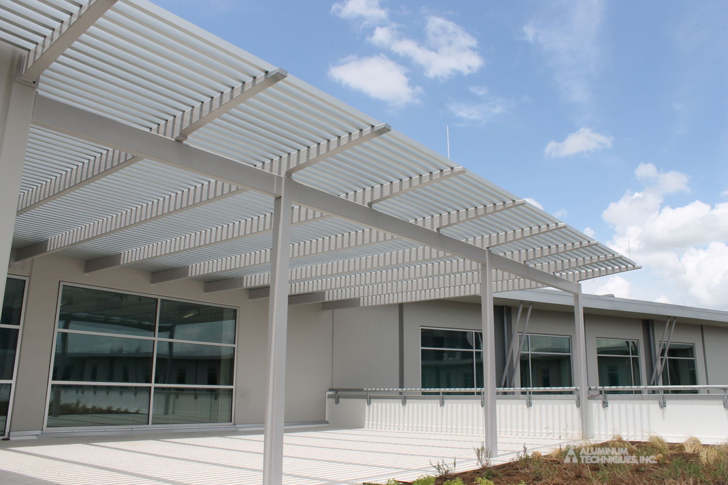 Showing a sun control structure near the front of a building.