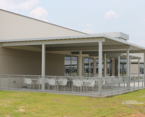 Showing an aluminum shade structure providing cover for outdoor dining.