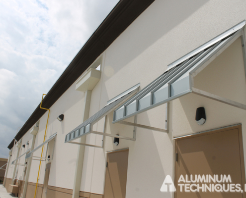 Showing outdoor canopies protecting the back doors of shopping center.