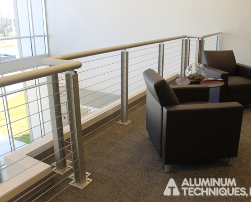 Showing a custom aluminum railing inside a building.
